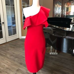 Red one sleeve with ruffle dress, from Zara.